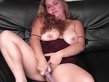 Mature fat brunette is masturbating