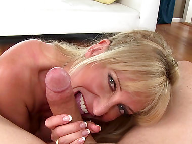 MILF Olivia Parrish is giving a blowjob