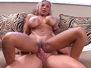 Busty tanned brunette is getting fucked in ass