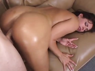 Oiled mom is getting drilled hard in her booty