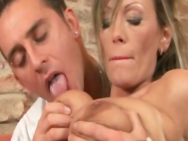 MILF is sucking her lovely tasty dildo