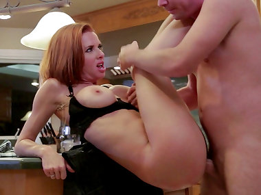 Redhead mommy is banging with young dude
