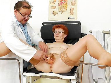 Redhead mature Jindriska is sitting with spread..