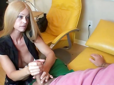 Clothed blonde is giving an awesome handjob