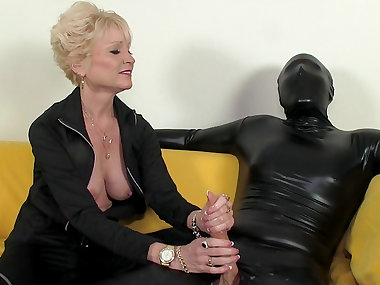 Mature mistress and her slave in latex