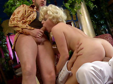 Curly blonde being drilled by two hard poles