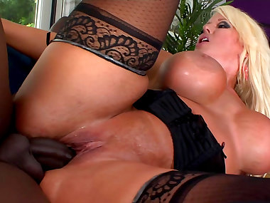 Busty blonde wearing stockings gets fucked by..