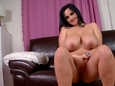Brunette Roxana shows off her really big boobies