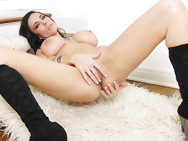 Dark-haired pornstar is rubbing her twat on the..