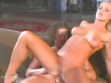 Smoking hot blonde with big tits rides cock on the sofa