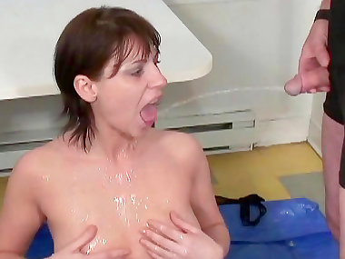 Chubby brunette receives a facial and a golden rain