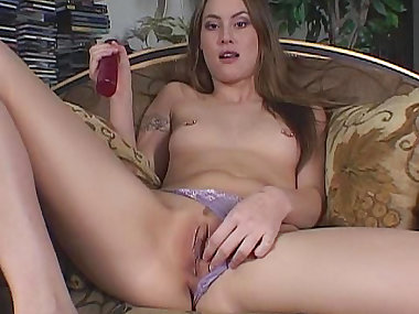 Amateur babe is poking her puss with a dildo