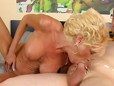 Mature blonde is sucking a hard dick