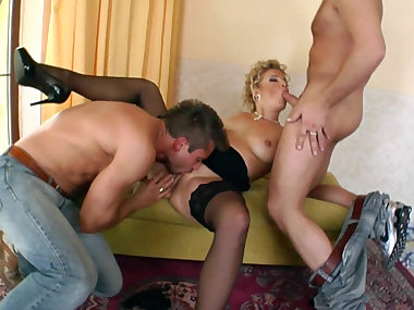 Luciana sucking two cocks in the same moment
