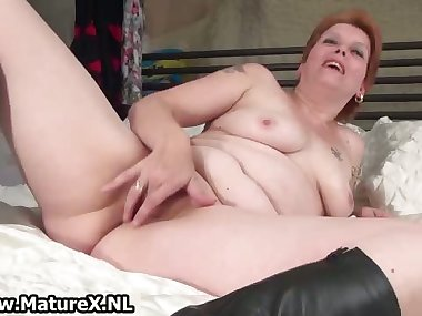 Mature mom laying on the bed and rubbing part4