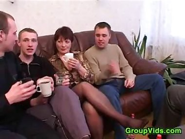 Mature Woman With Four Guys
