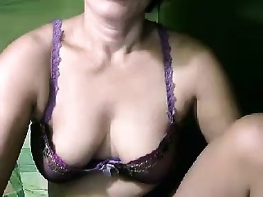 Naughty Oriental mom putting her big breasts on display on