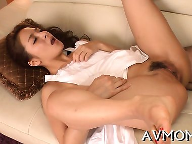 Hot oriental mom in heels gets stripped and fucked on bed