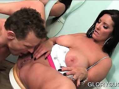 Wet mom giving BJ and tit job on gloryhole