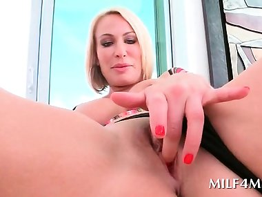 Gorgeous blonde mom rubs her pink snatch