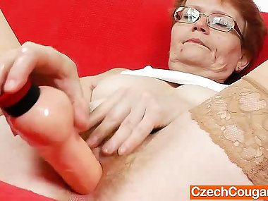 Amateur-mom solo with a dildo