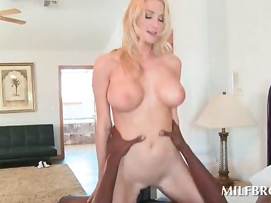 Sex siren mom riding black shaft in bed