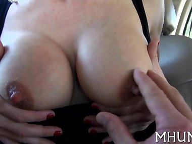 big jugs slut has a tease session on that silver couch