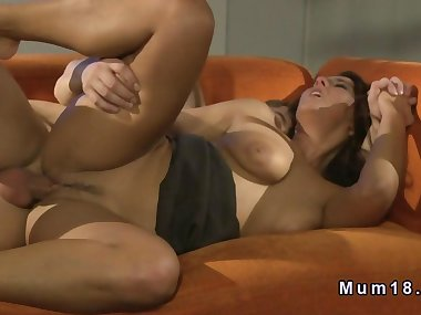 Hot busty tanned mom bangs on the sofa