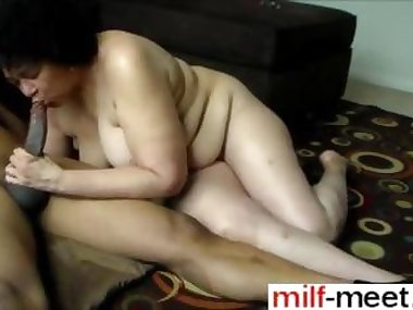 Fat old wife polishes a giant black cock and fucks