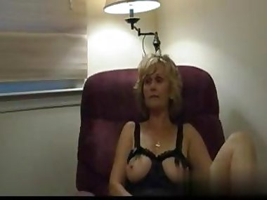 busty blonde has a wank session