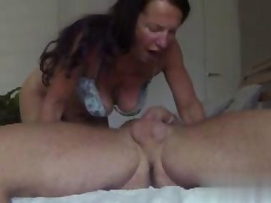 Sexy MILF with brunette hair sucks some hard cock in bed