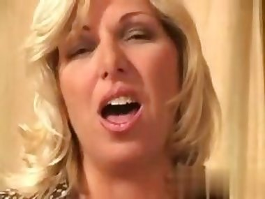 Cougar MILF rides a hard young dick in bed