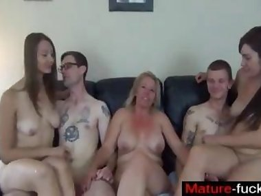 Three wild chicks start a group fucking session on the couch
