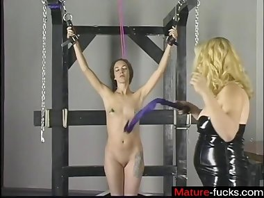 domina is spanking the ass of her slutty ass sub