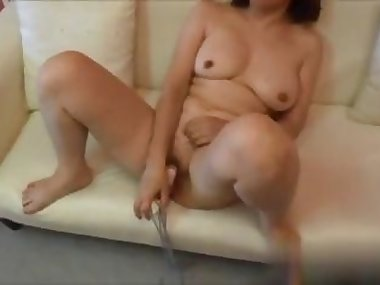 Petite Asian MILF tries out new toys and loves them