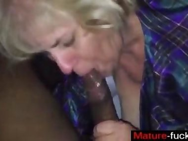 old one has a fat dick in her experienced mouth