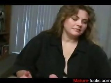 she is a mature slut wanking on the dudes hard cock