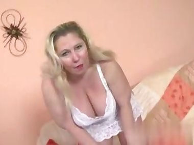 Blonde MILF mature teases her pussy with a sex toy