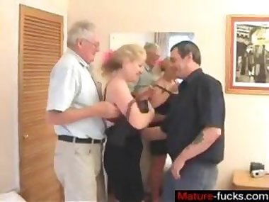 Curly old blonde fulfills her threesome fantasy on camera