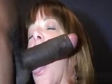 Busty MILF slobbers a giant black dick in 69