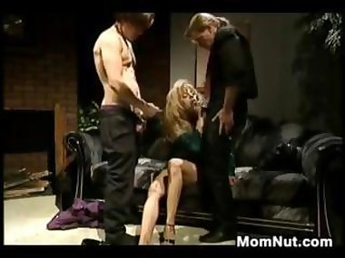 Busty milf fucks two rock hard guys